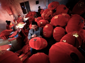 Tired Worker making Red Lanterns