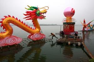 Man preparng setting the Dragon on the lake